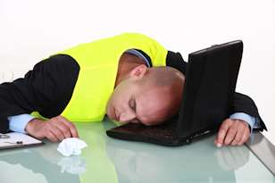 man-sleeping-on-laptop