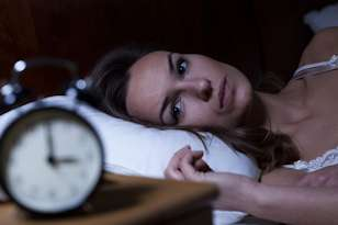what is insomnia woman awake clock insomnia