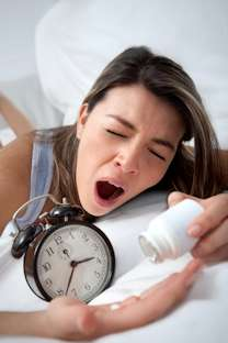 natural remedies for insomnia woman popping sleeping pills
