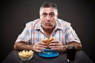 grain brain diet man eating burger